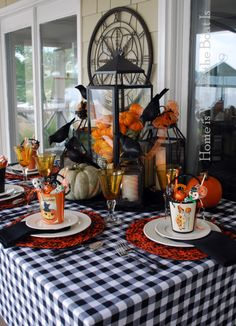 Halloween table scape- like lantern filled with mini pumpkins