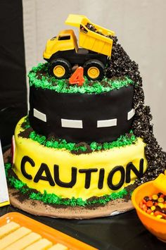Dump truck cake at a construction birthday party! See more party planning ideas at http://CatchMyParty.com!