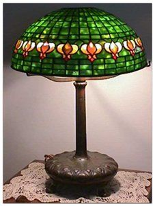 "Common but often lovely Tiffany Studios ""pomegranate"" pattern table lamp."