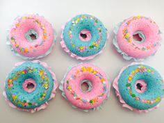 AD: Handmade donut bath bombs! These donut bath bombs are so dang precious and whimsical. Each bath bomb is two donut halves sandwiched together with a hard meringue frosting in the middle and then showered with happy, colorful sprinkles. They are scented with your choice of Coconut, Sandalwood Rose, or Lavender.