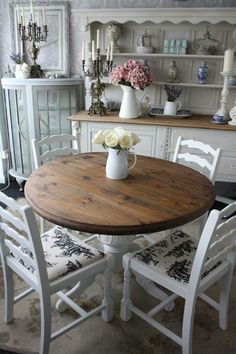 brown, wodden table and white table legs with white chairs <3