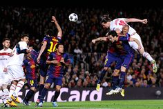 Zlatan Ibrahimovic climbs above Daniel Alves