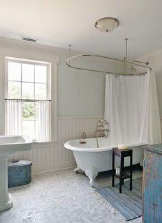 Clawfoot tub, beadboard wainscoting, and hex tile—always a good combo. Clawfoot Tub Bathroom, Bathroom Renos, White Bathroom, Small Bathroom, Bungalow Bathroom, Bathroom Flooring, Beadboard Wainscoting, Upstairs Bathrooms, Guest Bathrooms