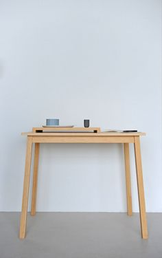 Little Bamboo is a small table with a tray. The tray defines a workspace on a surface. The tray is not connected to the table top. You're able to use the tray as a separate element or use the total Light Oak, Small Tables, Types Of Wood, Bamboo, Desk, Interior, Furniture, Tray, Laptop