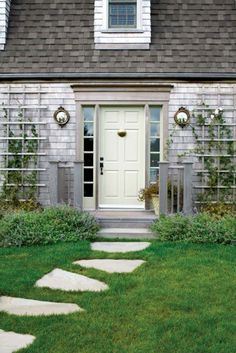 The porthole windows flanking either side of the front door is brilliant!