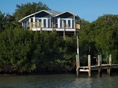 Little Gasparilla Island waterfront. - HomeAway Little Gasparilla Island Little Gasparilla Island, Flood Zone, Renting A House, Ideal Home, French Doors, Condo, Home And Family, Cottage, House Styles