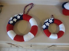 4th of July Yarn wreaths.14 and 10 inches.You need a hot glue gun,hot glue sticks, your choice of wreath from any craft store and Red,White and Blue Yarn. Just wrap yarn around the wreath to desirde width of colored section hot glue end. Repeat with next color. For the stars I corcheted them and then hot glued them on. Crochet Star pattern: Chain 5, slip stitch to join, chain 3, slip stitch in second stich from hook then half double crochet in next chain, slip stich to hook. Repeat 4 more ti...