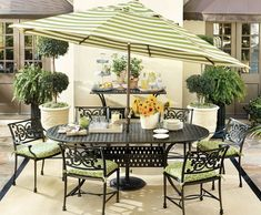 Anchor an outdoor dining space with a big umbrella and an outdoor rug.
