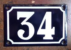 vintage French house number 34 enamel blue and white. $35.00, via Etsy.