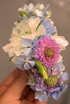 Floral comb featuring blue hydrangea, purple scabiosa, white scabiosa, and lisianthus buds