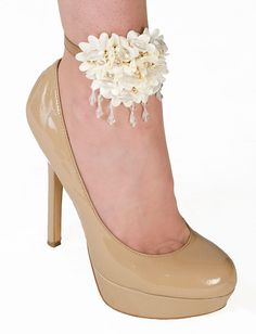 How classy is Sher?  Cream silk flowers with crystal & gold beads will add elegance to your New Year's Eve outfit!