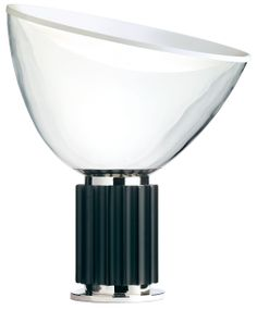 Pushing design to the level of art, Achille Castiglioni creates brilliantly imagined objects that illustrate his love of paradox and, at the same time, a thoughtful concern for a formal balance. An example of this is his Taccia Table Lamp (1962), which he created with older brother Pier Giacomo Castiglioni. The design is like an upside down hanging lamp. Covering the top of a deep translucent glass bowl is a concave sheet of spun aluminum in a matte white finish. This sheet acts as a…