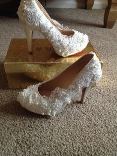 Brand new ivory bridal shoes for sale.Beautiful lace shoe with pearl detail size 5.