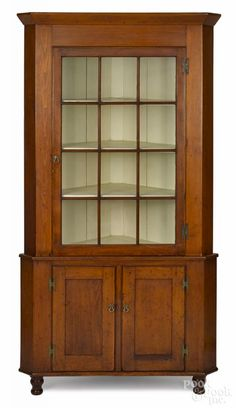 Pennsylvania pine corner cupboard, 19th c., in two parts, 82 1/2'' h. 44'' w.    Price Realized $3,000