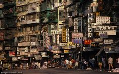 Inside the Kowloon Walled City where 50,000 residents eked out a grimy living in the most densely populated place on earth    Read more: http://www.dailymail.co.uk/news/article-2139914/A-rare-insight-Kowloon-Walled-City.html#ixzz1uP5yGDc2
