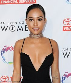 Revealing! The ex-girlfriend of Chris Brown nearly spilled out of the low-cut number which showcased her ample cleavage