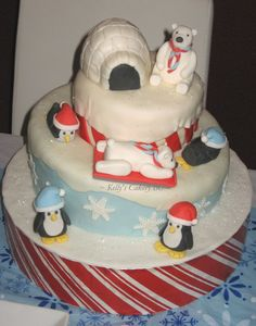 "Winter Wonderland cake. Gumpaste/fondant penguins and polar bears, fondant-covered RKT igloo.Base is a styrofoam cake dummy covered in candy-cane patterned paper and fondant ""snow"", middle layer is topsy-turveyed."