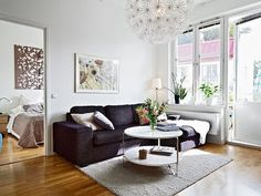 Black sofa with white table