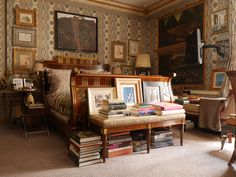 Howard Slatkin:  Stacks of art and design books have been placed atop and tucked under a bench at the foot of the mahogany-and-brass Russian bed in his master bedroom.