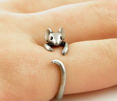 This ring is made in the shape of a mouse that wraps around your finger. They are one size fits all and is plated in silver. This is perfect for anyone looking for unique cute animal themed jewelry!