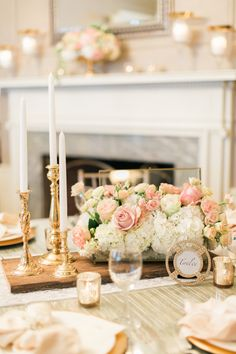 low flowers - roses and hydrangeas - and high candlesticks (note: not this color palette)