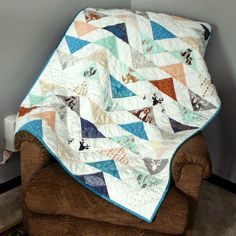 """Charming baby quilt made by Beth from The Zen of Ironing using going home to roost's fabric line """"Hello Bear"""" for Art Gallery Fabrics and Aurifil Thread. """"I used #Aurifil for the first time, in three different colors. Hawthorne Threads , where I buy a lot of my fabric, matches solids and Aurifil colors to fabric collections and it's awesome. It can be really hit or miss trying to match colors online, and they do an excellent job.  To find out more about this quilt please visit…"""