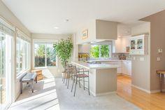 Traditional Kitchen with Stone Tile, Bora Bora Beige, Quartz, Limestone Tile, Carpet, Raised panel, Hardwood floors, U-shaped