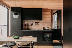 Finnish designers Aleksi Hautamaki and Milla Selkimaki purchased a island two years ago, on the edge of the Archipelago National Park in Finland, and have since built this self-sufficient summer house that includes a sauna, a guesthouse and a Wooden Cabins, Wooden Decks, Scandinavian Cabin, Scandinavian Architecture, Timber Cabin, Cuisines Design, Modern Kitchen Design, Archipelago, Studio