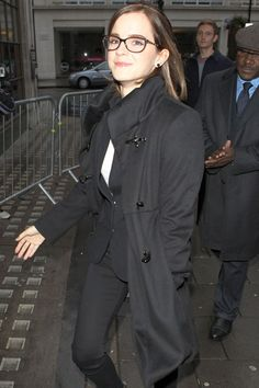 Emma Watson arriving at the BBC Radio 1 studios wearing a black blazer, jeans and overcoat, accessorised with brown boots and Chanel glasses. LOVE THE GLASSES