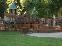 1400 square ft wooden fort play area.   416 Mullan Road   Coeur d'Alene, Idaho -- the circle swing that you hang off of with your arms is AWESOME!!!!