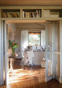 Create a partition with shelves or an Ikea bookcase and a couple of louvre doors