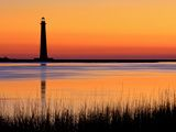 Silhouetted Morris Island Lighthouse at Sunrise Photographic Print by Robbie George