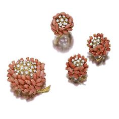 A suite of coral and diamond jewelry, Van Cleef & Arpels, French comprising a brooch, designed as a flower, with navette coral cabochon petals, centering circular-cut diamond pistil and extending a textured gold stem, a pair of earclips and a ring en suite; all signed Van Cleef & Arpels, with French assay marks and maker's mark.
