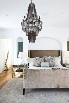 Love this neutral bedroom with all its textures & architectural details. The huge chandelier takes this room to a whole new level.