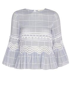 Jonathan Simkhai Voile Grid Shirt: Tonal grid pattern detailed with embroidery. Round neckline. Button closure at keyhole back. Ruffled hem and long sleeve cuffs. In very pale blue. Fabric: 100% cotton Made in China.      Model Measurements: Height 5'10 1/2; Waist 24 ; Bust 31 wearing ...