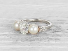 1.29 CARAT EARLY ART DECO DIAMOND AND CULTURED PEARL THREE STONE RING