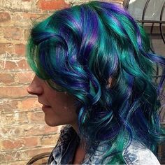 Gorgeous green and blue… | 29 Creative And Colorful Hair Trends To Try This Summer from Buzzfeed.