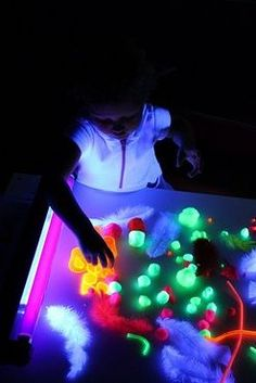 Materials:    Black light    Things that glow in the dark: NEON pom poms, pipe cleaners, dollar store shot glasses, acrylic tiles, pony beads, feathers, glow in the dark or neon paint, glow in the dark or neon sand.  Paper    Glue (we used clear)
