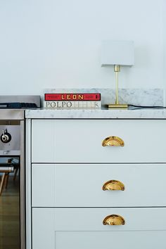 Brass cabinet pulls in kitchen of Isabel and George Blunden London renovation | Remodelista