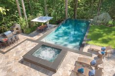 Hillside infinity pool with raised spa and outdoor kitchen. Pool by Lewis Aquatech, Chantilly, VA http://www.luxurypools.com/swimmingpoolbuilder/Lewis-Aquatech-Pools?fid=369