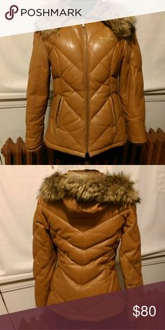 Vintage Baby Phat Hooded Down Coat-authentic Fave coat, used w/love until it no longer fit Genuine leather Chevron quilted Shell - Golden Tan color 50% Duck Down/50% Feather fill Body lined w/champagne color baby phat logo lining Hood lined w/diamond quilted satin matching the leather Detachable faux fur hood trim Gold tone logo zippers Rib storm cuffs keep wind out 2 zipper pockets Hip length Overall good condition. Some natural wear on the leather pocket openings, sleeve seams, armhole…