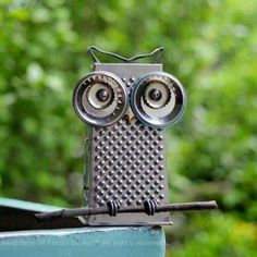 Junk metal Art Owl from cheese grater and metal lids, bottle caps, etc. Recycling at its finest