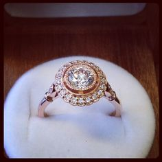 Vintage details, contemporary elegance. Love this unique take on a halo and love the rose gold. #engagement
