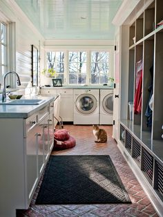 The abundance of natural light, plenty of storage space and the company of four-legged friends takes away the drudgery of chores in this mudroom.