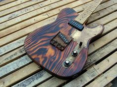 Burnt wood Telecaster relic.