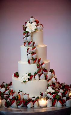 Instead of flowers on a wedding cake do chocolate covered strawberries- best idea ever
