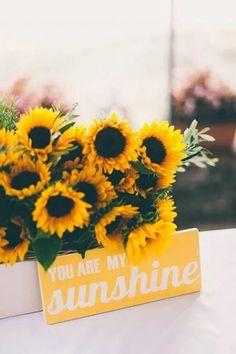 Simple sunflower wedding arrangement and rustic wedding sign