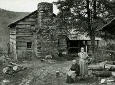 "Cabin in The Great Smoky Mountains. Photo 1962. Farm of John & Margaret Walker & their 11 children.  c. 1870. In 1962, the 2 remaining sisters - Margaret Jane (1872-1962) & Louisa Susan (1882-1964) were selling hand-written poems & ""sovioners"" to tourist to make ends meet.    Now restored & maintained by the National Park Service"