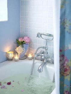 Romantic bath. Pink. Blue. Roses. Candles. Rose petals. Old fashioned.