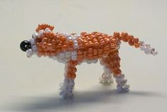 Free detailed tutorial with step by step photos on how to make a dog out of seed beads and wire in the technique of 3D beading. Great for beginners!